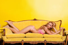 Beautiful woman posing in a yellow interior Royalty Free Stock Images
