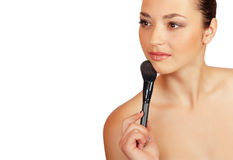 Beautiful woman with powder brush Stock Images