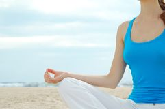 Beautiful woman practice yoga on the beach Royalty Free Stock Photos