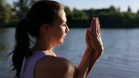 Beautiful woman practice yoga on a nature,close-up stock video