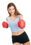 Beautiful woman practicing boxing Stock Photos