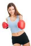Beautiful woman practicing boxing Stock Photos