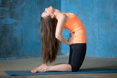 Beautiful woman practicing Kneeling Quad Stretch Royalty Free Stock Photography