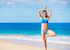 Beautiful woman practicing yoga Stock Images