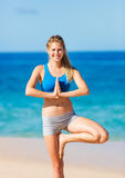Beautiful Woman Practicing Yoga on the Beach Royalty Free Stock Image