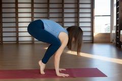 Beautiful woman practicing yoga indoors stock photo