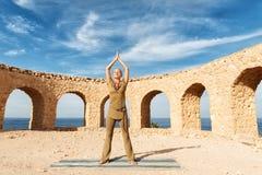 Beautiful woman practicing yoga stock photos