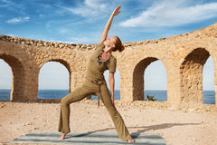Beautiful woman practicing yoga royalty free stock photo