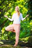 Beautiful Woman Practicing Yoga Outside In Nature Royalty Free Stock Photo