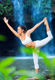 Beautiful Woman Practicing Yoga Outside In Nature Stock Photography