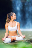 Beautiful Woman Practicing Yoga Outside In Nature stock images