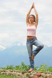 Beautiful woman practises yoga. Royalty Free Stock Images