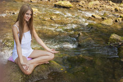 Beautiful Woman Practive Yoga On River In Nature Royalty Free Stock Images