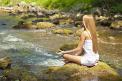Beautiful Woman Practive Yoga On River In Nature Stock Image