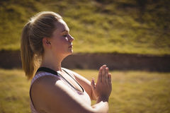 Beautiful woman praising yoga during obstacle course Stock Image