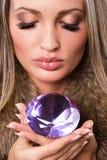 Beautiful woman with precious jewel. Closeup portrait of a beautiful woman with precious jewel Royalty Free Stock Photography