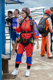 Beautiful woman prepares to skydive. Seville, Spain - May 7, 2016: Beautiful woman prepares to skydive. Skydive Spain is the skydiving center located at La Stock Photos