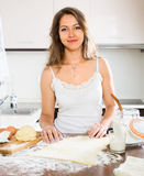 Beautiful woman preparing cakes of dough Stock Photos