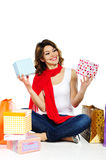 Beautiful woman with present boxes and shopping bags isolated Stock Images