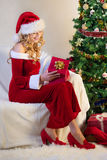 Beautiful woman with present in christmas eve Stock Photography