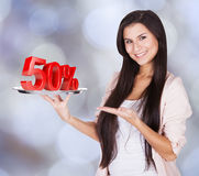 Beautiful Woman Presenting 50% Discount On Tray Royalty Free Stock Image