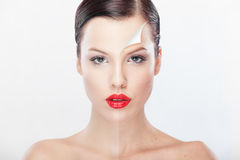 Beautiful woman presenting before and after retouching image. Royalty Free Stock Photo
