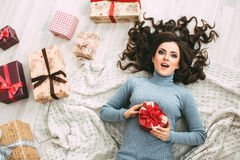 Beautiful woman with presents a top view. Royalty Free Stock Images