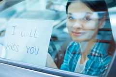 Beautiful woman pressing a farewell note to car window Royalty Free Stock Images