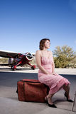 Beautiful woman with private plane Stock Photography
