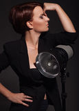 Beautiful woman with professional lighting Stock Photography
