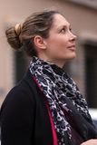 Beautiful woman profile pride. Beautiful model looking up / Pride expression / Wearing a scarf with hair tied back stock photo