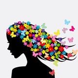 Beautiful woman profile silhouette with flowers and butterflies. Beautiful woman profile silhouette with colored flowers and butterflies in her hair Stock Photography