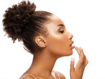 Beautiful woman in profile touching her lips. royalty free stock images