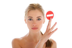 Beautiful woman with prohibiting sign Royalty Free Stock Images
