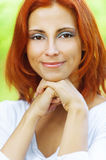 Beautiful woman propping up chin Royalty Free Stock Photography