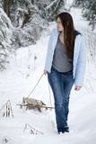 Beautiful woman pulling sled Royalty Free Stock Photos