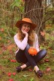 Beautiful woman with pumpkin Stock Photography