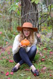 Beautiful woman with pumpkin Royalty Free Stock Image
