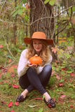 Beautiful woman with pumpkin Stock Images