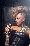 Beautiful woman punk with bass guitar profile Royalty Free Stock Photos
