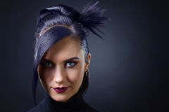 Beautiful woman punk on black background. Beautiful brunette with perfect hairstyle and professional makeup  . Beautiful woman punk on black background Royalty Free Stock Images