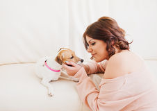 Beautiful woman with a puppy Royalty Free Stock Photography