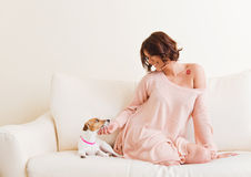 Beautiful woman with a puppy Stock Image