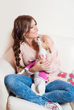 Beautiful woman with a puppy Royalty Free Stock Image