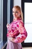 Beautiful woman in purple blouse Royalty Free Stock Image