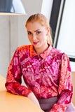 Beautiful woman in purple blouse Stock Photography