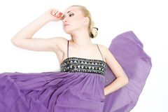 Beautiful woman in purple dress Stock Images