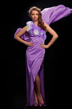 Beautiful woman in the purple dress Stock Photo