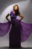 Beautiful woman in the purple dress Royalty Free Stock Photography
