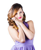 Beautiful woman in purple dress Stock Image